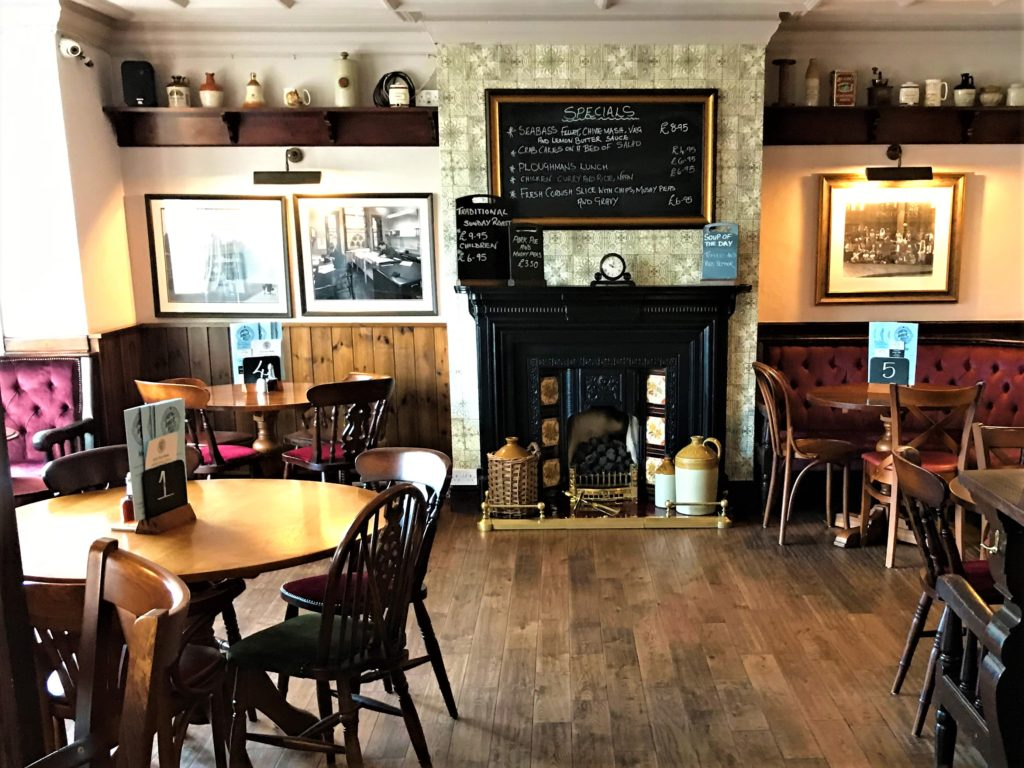 Ring O' Bells Shipley historic pub fireplace and dining tables